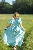 Blond in vintage dress in the field Stock Photos