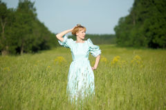 Blond in vintage dress in the field Royalty Free Stock Image