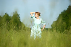 Blond in vintage dress in the field Stock Image