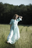 Blond in vintage dress in the field Royalty Free Stock Images