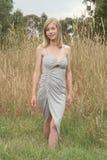 Blond walking on grass Royalty Free Stock Image