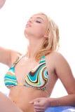 Blond warm woman in bikini Stock Photography