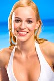Blond warm woman in bikini Stock Images