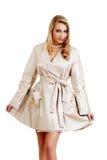 Blond wearing a rain coat Stock Image