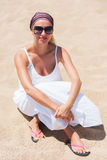 Blond in white dress on a beach Stock Photography