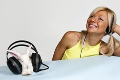 Blond and white rabbit listening to music Royalty Free Stock Photo