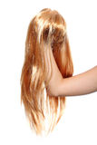 Blond wig. A picture of a blond wig over white background Stock Photo