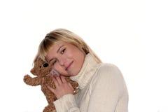 Blond wijfje met teddybeer stock fotografie