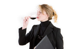 A blond wine taster. A business woman tasting wine Stock Photos