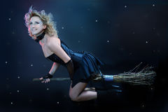 Blond witch flying on broom Stock Image