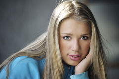 Blond woman. Beautoful blond woman is posing royalty free stock photography