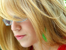 Blond woman. A profile of a blond woman with spectacles, with her long locks obscuring part of her face stock photos