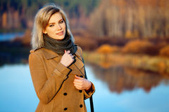 Blond woman against autumn nature landscape Royalty Free Stock Photos