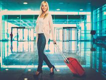 Blond woman in airport Royalty Free Stock Photography
