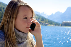 Blond woman angry on the phone closeup Royalty Free Stock Photography