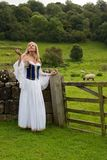 Blond woman in antique costumes royalty free stock image