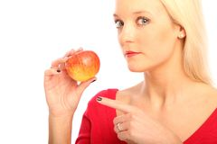 Blond woman with a apple Stock Photos