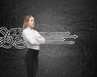 Blond woman and arrows going straight Stock Photography