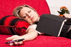 Blond woman asleep with E-Cigarette Royalty Free Stock Image