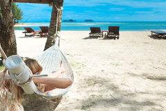 Blond woman asleep in a hammock. Royalty Free Stock Image