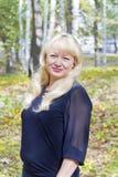 Blond woman in autumn Stock Photo