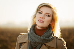 Happy blond fashion woman in autumn field Royalty Free Stock Photos