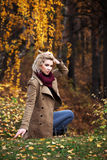 Blond woman in autumn forest Stock Image