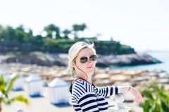 Blond woman in aviator sunglasses Royalty Free Stock Images
