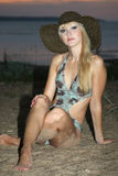Blond woman in bathing suit and hat Royalty Free Stock Image