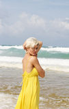 Blond woman at the beach. Royalty Free Stock Image