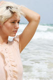 Blond woman at the beach. Stock Photo