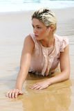 Blond woman at the beach. Royalty Free Stock Photography