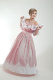 Blond woman in beautiful pink dress Royalty Free Stock Image