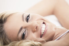 Blond woman in bed Stock Photos