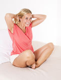 Blond woman in bed Stock Photo