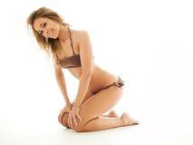 Blond woman in bikini royalty free stock photography