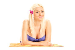 Blond woman in bikini lying on a towel Royalty Free Stock Image