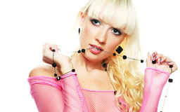 Blond woman biting beads Royalty Free Stock Photo