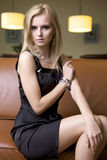 Blond woman in black dress Stock Photography