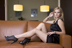 Blond woman in black dress Stock Photo
