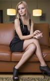 Blond woman in black dress Stock Photos