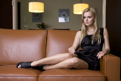 Blond woman in black dress Royalty Free Stock Photos
