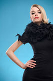 Blond woman with black formal dress Royalty Free Stock Image