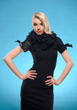 Blond woman with black formal dress Royalty Free Stock Images