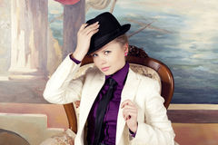Blond woman in black hat Royalty Free Stock Photos