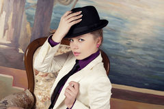 Blond woman in black hat Royalty Free Stock Images