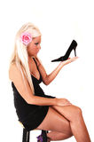 Blond woman with black heel. Royalty Free Stock Photo