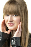 Blond woman with black leather jacket Stock Images