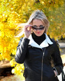 Blond woman in black leather jacket Royalty Free Stock Image