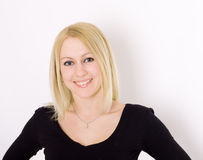 Blond woman in black. Blond woman in black, portrait on white background Royalty Free Stock Photography